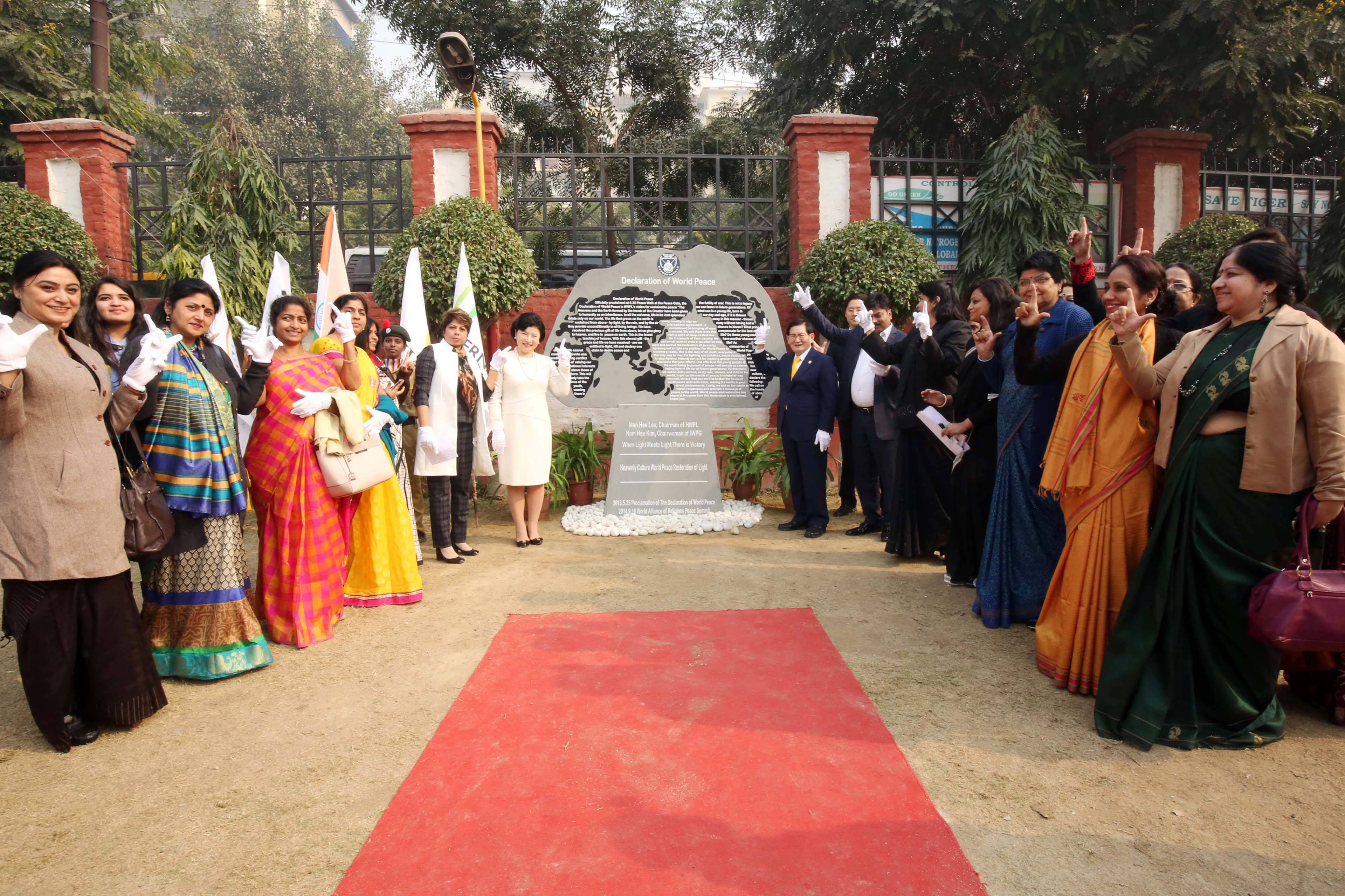 Chairman Lee of HWPL and Chairwoman Kim of IWPGwith Ramagya Schoolrepresentatives at the unveiling ceremony of the Monument