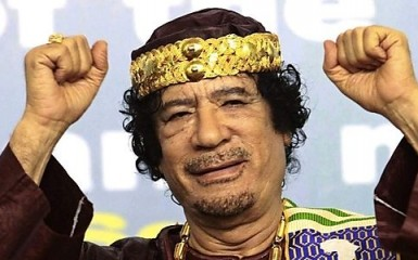 Libya's leader Muammar Gaddafi gestures as he attends the Second Forum for Kings, Sultans, Princes, Sheikhs and Mayors of Africa in Tripoli September 8, 2010. Picture taken September 8, 2010. REUTERS/Ismail Zitouny (LIBYA - Tags: POLITICS IMAGES OF THE DAY)
