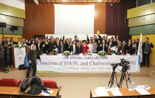 Students of University of Pristina are joyfully taking a group photo with t