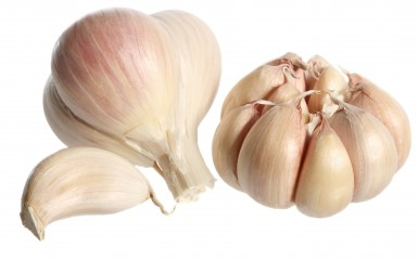 Two bulbs and clove of garlic, isolated on white background