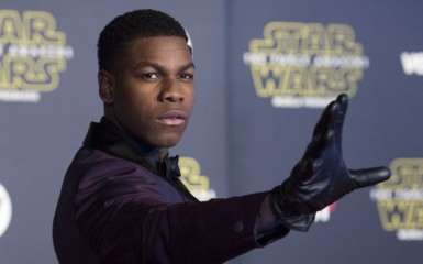 "Actor John Boyega attends the World Premiere of ""Star Wars: The Force Awakens"", in Hollywood, California, on December 14, 2015.AFP PHOTO /VALERIE MACON / AFP / VALERIE MACON        (Photo credit should read VALERIE MACON/AFP/Getty Images)"