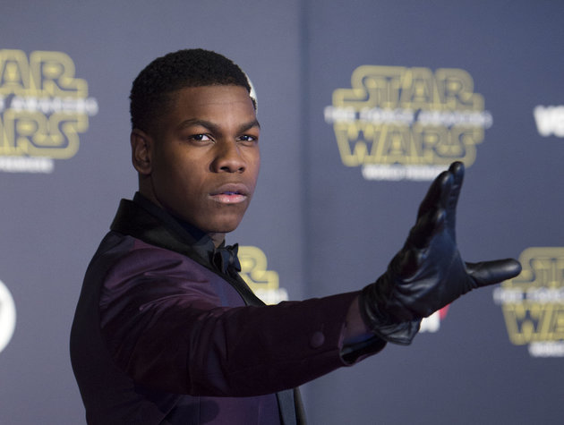 """Actor John Boyega attends the World Premiere of """"Star Wars: The Force Awakens"""", in Hollywood, California, on December 14, 2015.AFP PHOTO /VALERIE MACON / AFP / VALERIE MACON        (Photo credit should read VALERIE MACON/AFP/Getty Images)"""