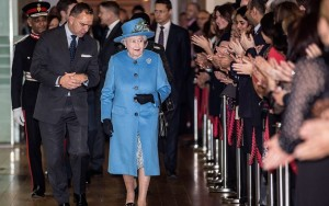 Ken Olisa, far left, helps escort the Queen on her tour of the Home Office in London