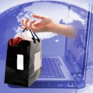 retail shopping bag coming out of computer with world in background